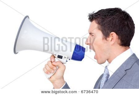 Young Businessman Yelling Through A Megaphone