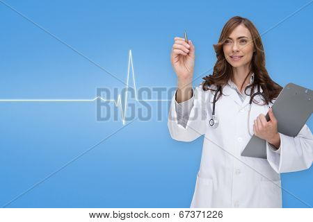 Smiling doctor pointing against medical background with blue ecg line