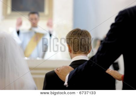 Groom's Parent Blessing Him During Wedding Ceremony