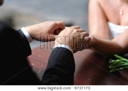 Bride And Groom's Hands With The Wedding Rings