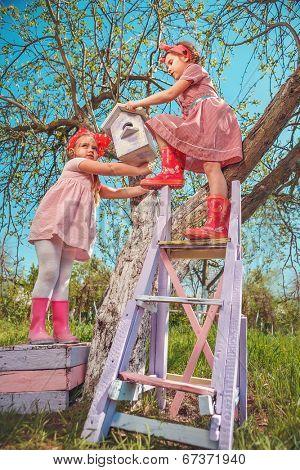 Children installing a self-made Bird House.