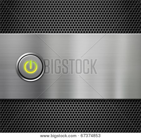 computer power or start button on metal background
