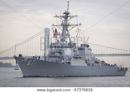 STATEN ISLAND, NY - MAY 21, 2014: Guided-missile destroyer USS Cole (DDG 067) approaching Sullivans Piers with the Verrazano-Narrows Bridge in the background.  The ship is part of Fleet Week NY.