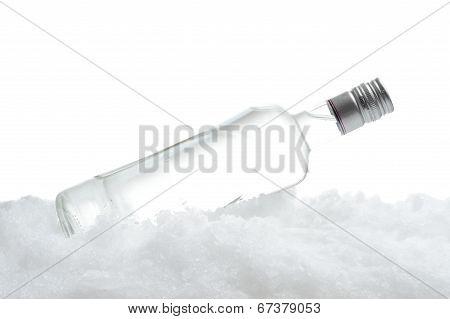 Bottle Of Vodka Lying On Ice On White Background