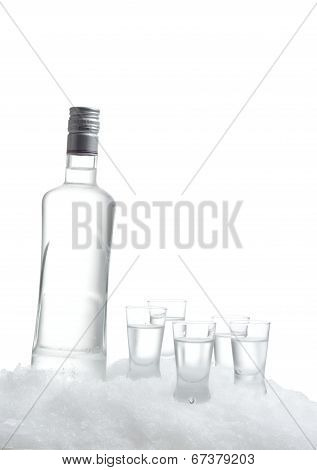 Bottle Of Vodka With Glasses Standing On Ice On White Background