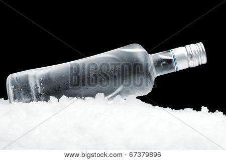 Bottle Of Vodka Lying On Ice On Black Background
