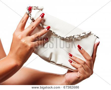closeup of the woman's hand wearing red half moon nail art manicure with white leather bag with silver chain bag, isolated on white studio background