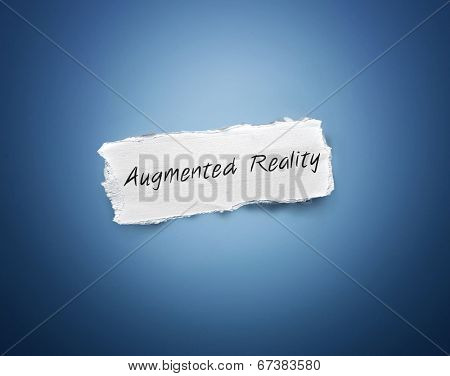 Word - Augmented Reality - written on a torn rectangular scrap of white paper on a blue background with a vignette