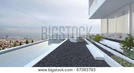 Modern luxury house with panoramic view windows overlooking a patio laid to pebbles with swimming pool and cityscape in the background