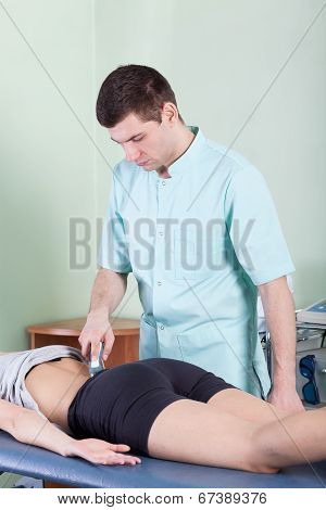 Treatment Of Back Pain By Laser Therapy