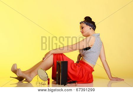Full Length Of Fashionable Pin-up Girl With Bun On Yellow