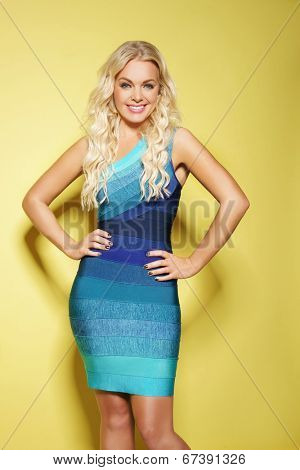 Studio shot of a beautiful young woman with bright blue eyes wearing dress