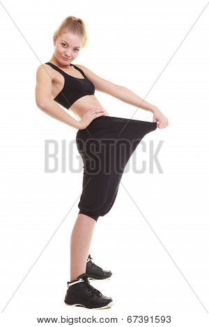 Happy Woman Showing How Much Weight She Lost, Big Pants
