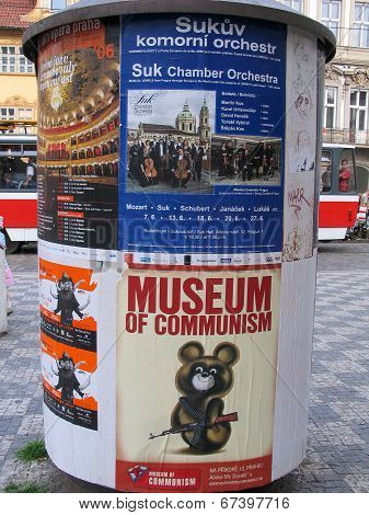 Prague, Czech Republic - June 15, 2006: Advertising Pillar With Museum Of Communism Banner In Old To
