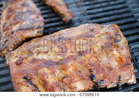 Spareribs On Grill With Dip And Toasted Baguette