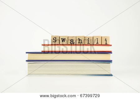 Swahili Language Word On Wood Stamps And Books