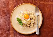 stock photo of carbonara  - Pasta Carbonara with parmesan and yolk on textured background - JPG