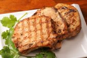 stock photo of pork cutlet  - Roasted pork chops on white dinner plate - JPG