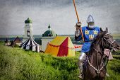 pic of armor suit  - Armored knight on warhorse over old medieval castle and camp - JPG