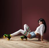 pic of pre-adolescents  - woman posing in a vintage roller skates in a dark room - JPG