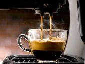 foto of descending  - espresso that descends gently into the cup and handsomely glass - JPG