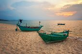 picture of old boat  - Old fishing boat at the beach in sunset time - JPG