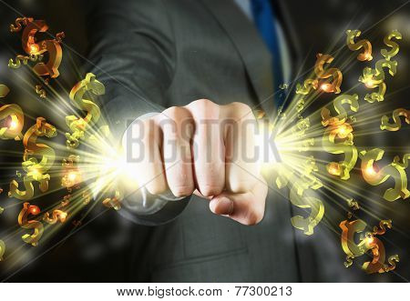 Close up of businessman grasping dollar signs in fist