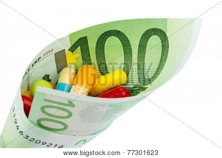 tablets and one hundred euro banknote symbol photo for charges for medicine and drugs the pharmaceutical industry