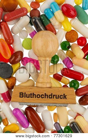 stamp on colorful tablets, symbolic photo for high blood pressure, prescription and medication