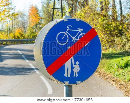 sign for bike path and walkway. each other on the road