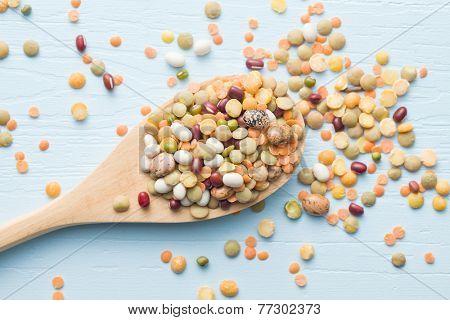 mixture of legumes in wooden spoon