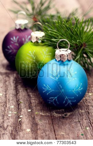 Christmas decoration ball on textured grungy wooden surface