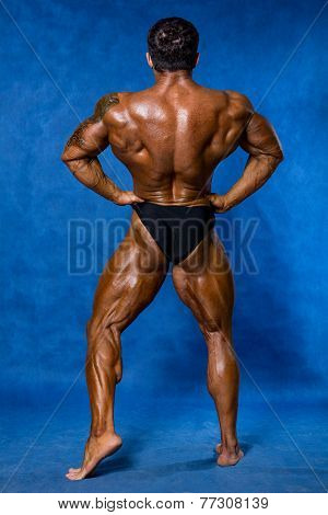Athletic Sports Bodybuilder Demonstrates Posture From The Back