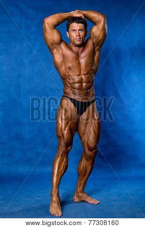 Bodybuilder Flexing His Muscles.
