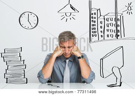 Portrait Of Nervous Businessman Sitting At His Office Desk