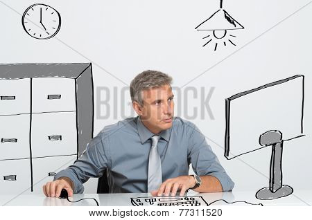 Absorbed business man working at computer in office