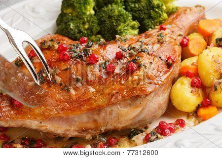 roasted turkey leg being sliced- christmas dish