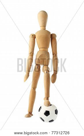 mannequin old wooden dummy acting about soccer isolated on white