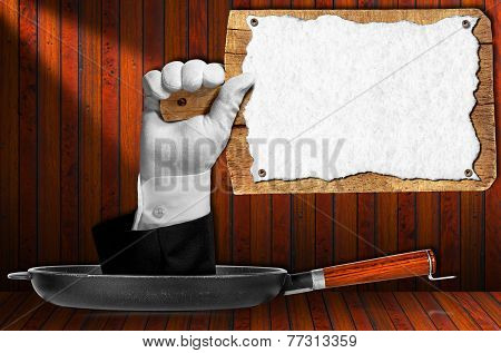 Hand Holding A Wooden Cutting Board
