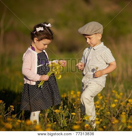 boy and girl in summer field