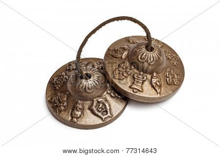 Tibetan Buddhist tingsha cymbals isolated on white