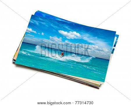 Holidays beach adventure concept creative background - stack of vacation photos with man riding jet ski image on top isolated on white background