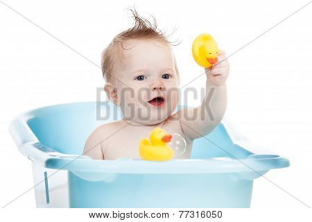 adorable child taking bath in blue tub