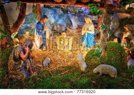 Traditional Christmas Nativity Scene With Baby Jesus, Mary, Joseph And Shepherds In Barn