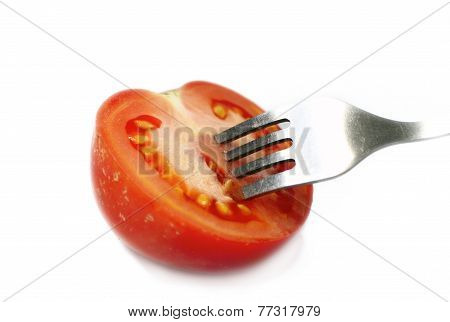 Fork Stuck In The Cut Tomatoes. Isolated Photo
