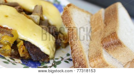 Plate Of Food And Sliced Bread