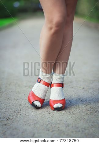 Red Sandals With White Socks On Girl Legs In Fifties Style