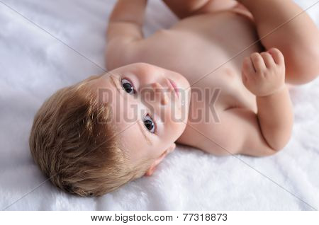 Blonde Baby Lying On Blanket With White Hair