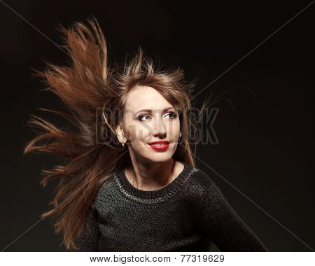 Portrait Of Young Beautiful Woman With Flying Long Hair