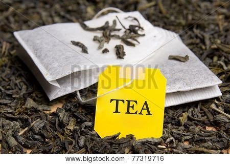Close Up Picture Of Two Tea Bags And Dried Tea Leaves